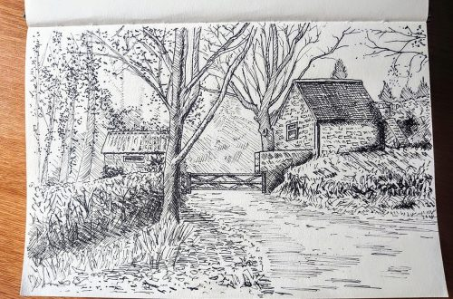 sketchbook showing a pen sketch of a sussex country house