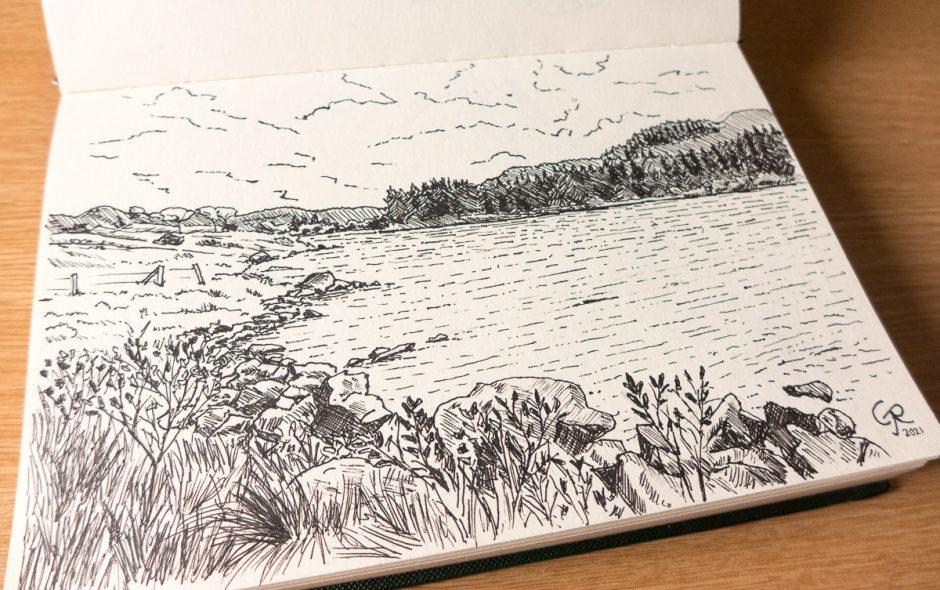 sketchbook showing a pen drawing of Llyn Mymbyr, Snowdonia, Wales