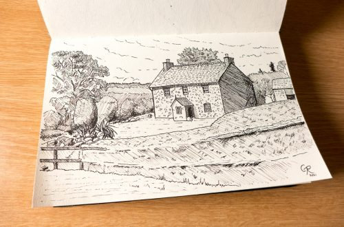 sketchbook showing an ink drawing of a cottage somewhere in Neath Valley