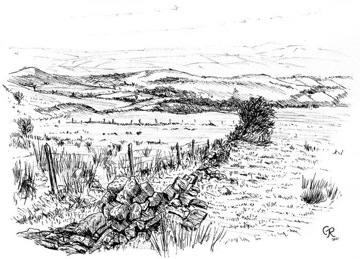 looking across countryside to the iron age hillfort carn goch